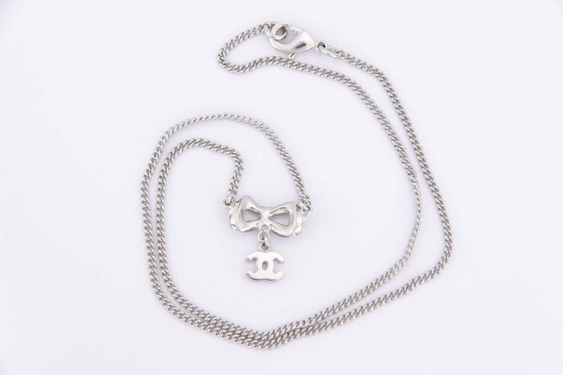 Attic House Necklace CHANEL NECKLACE SILVER BOWTIE PENDANT WDC, WITH BOX H-847-CHA