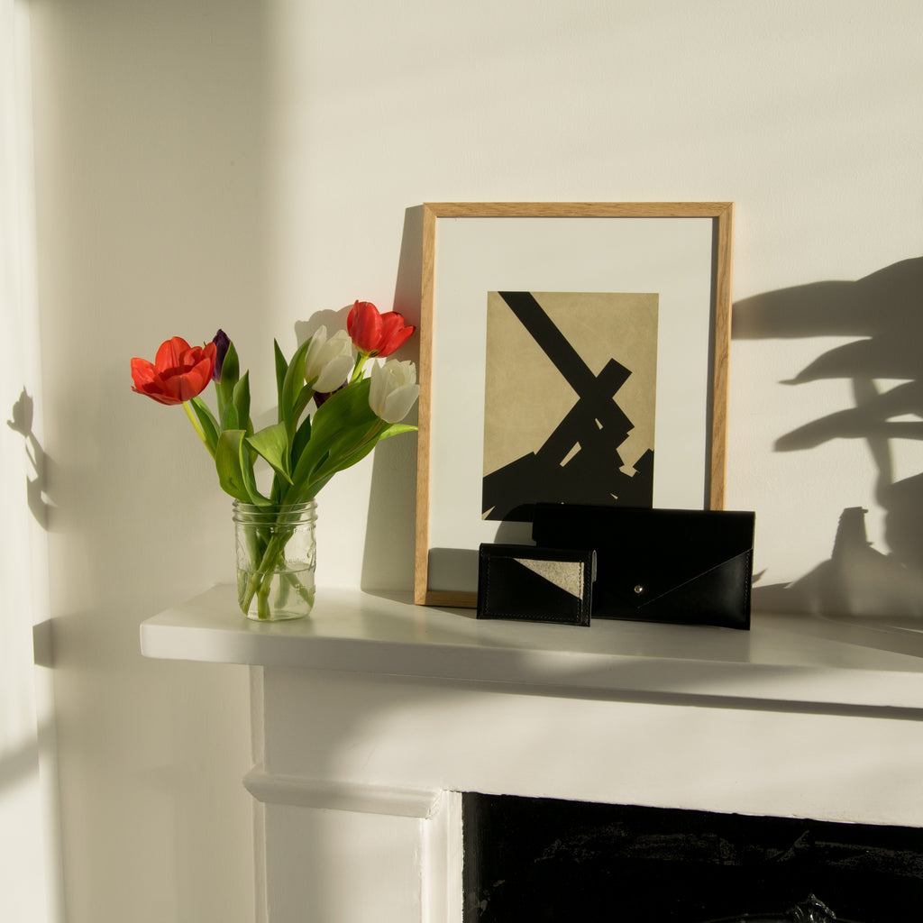 Leather Clutch Wallet and Leather Card Holder on Mantel with Tulips