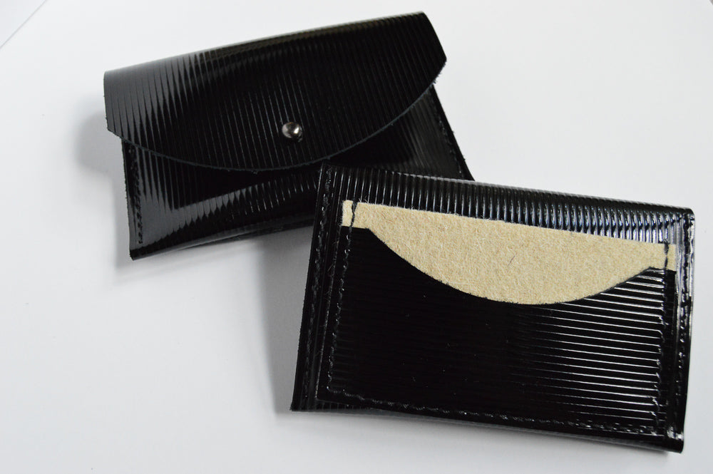 Front of half moon card holder and back of black and ivory half moon card holder.