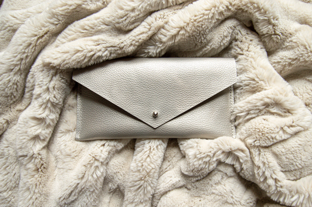 Pearl Clutch Wallet on Furry Blanket