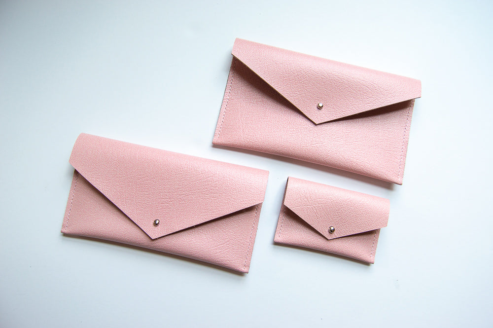 Pink leather collection: clutch wallet, envelope pouch and card holder.