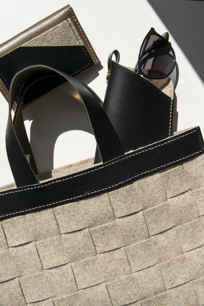 Woven market bag shown with leather sunglasses sleeve and card holder.