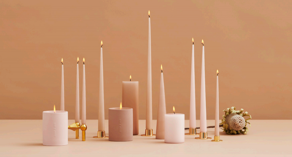 candles in shape of cone or taper candles and scented candles in natural wax handmade and non drip candles