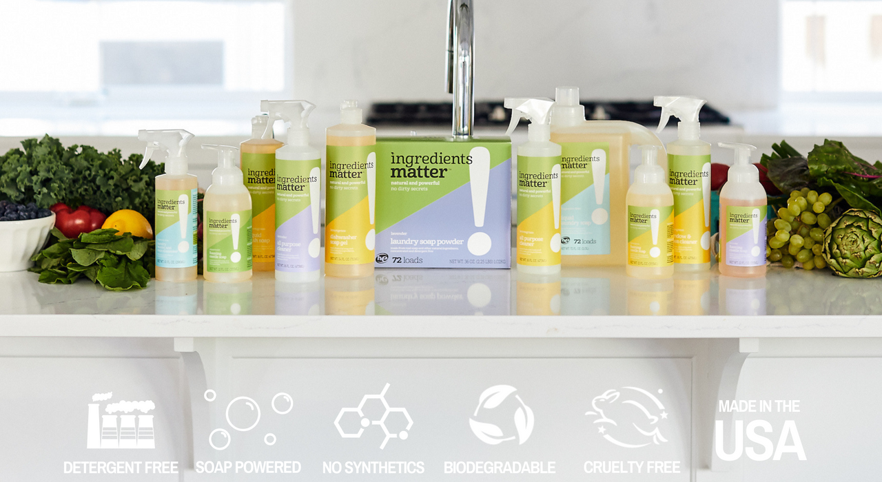 An assortment of Ingredients Matter natural cleaning products surrounded by produce plus logos that say detergent free, soap powered, no synthetics, biodegradable, cruelty free, and made in the USA