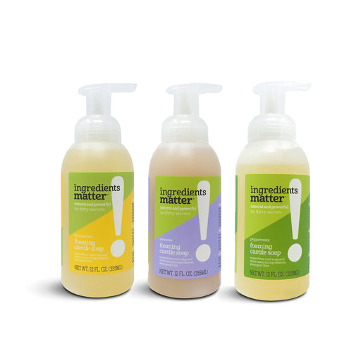 Three bottles of foaming hand soap in a row
