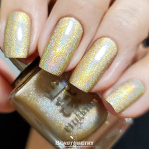 the hand refrains gold holographic nail polish