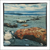 textile print of seaside boulders and embroidered sea life