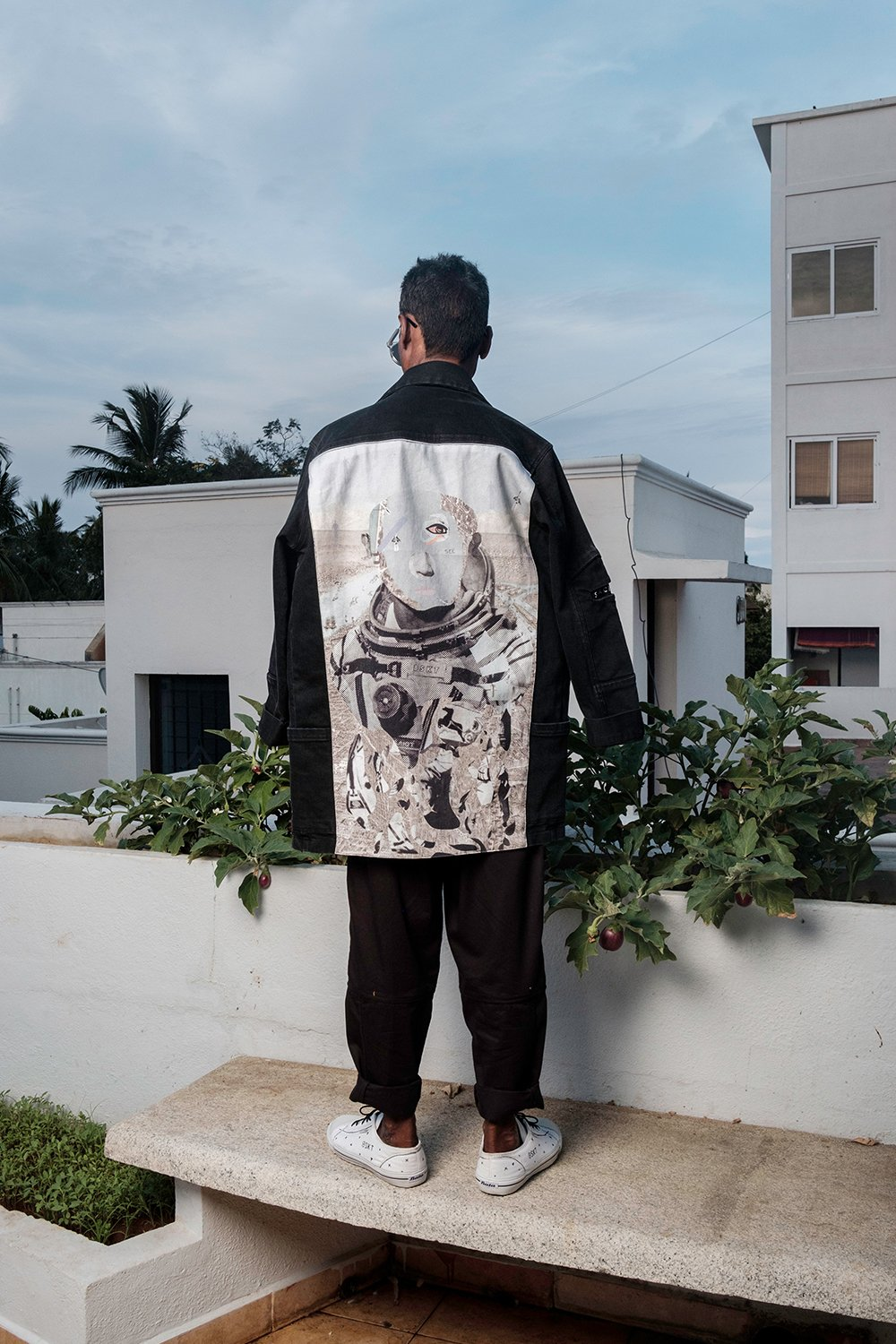 Unisex Functional Black Denim Jacket with multiple front pockets, SPACED OUT label on sleeve, and Rakesh Sharma Astro Print on Back Panel. Gender Neutral fit. Exploring the boundaries of art and design.