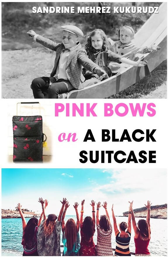 PINK BOWS ON A BLACK SUITCASE