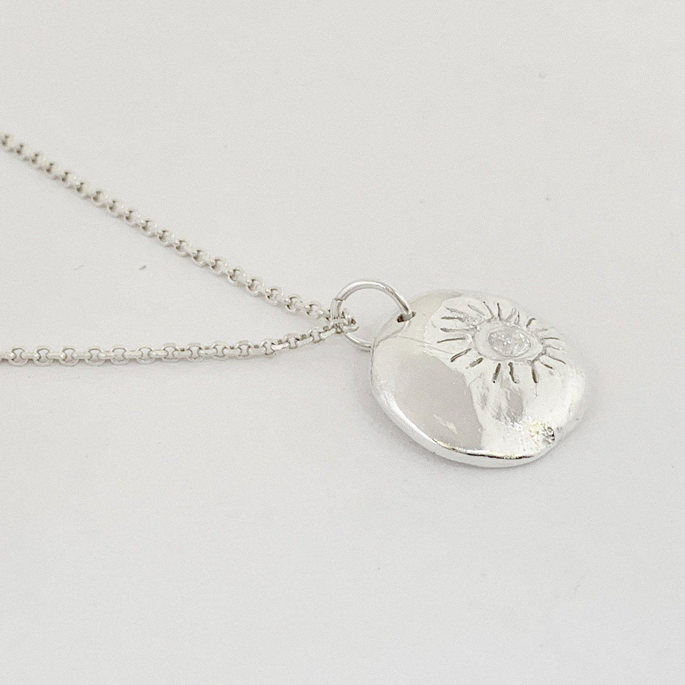 Hand Carved Silver Sun Necklace