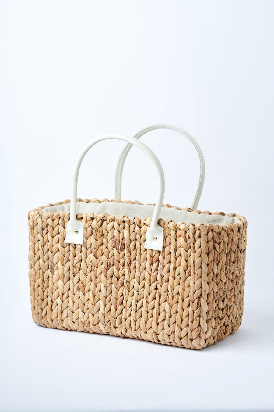 back view of medium natural hyacinth straw tote with linen cinch top
