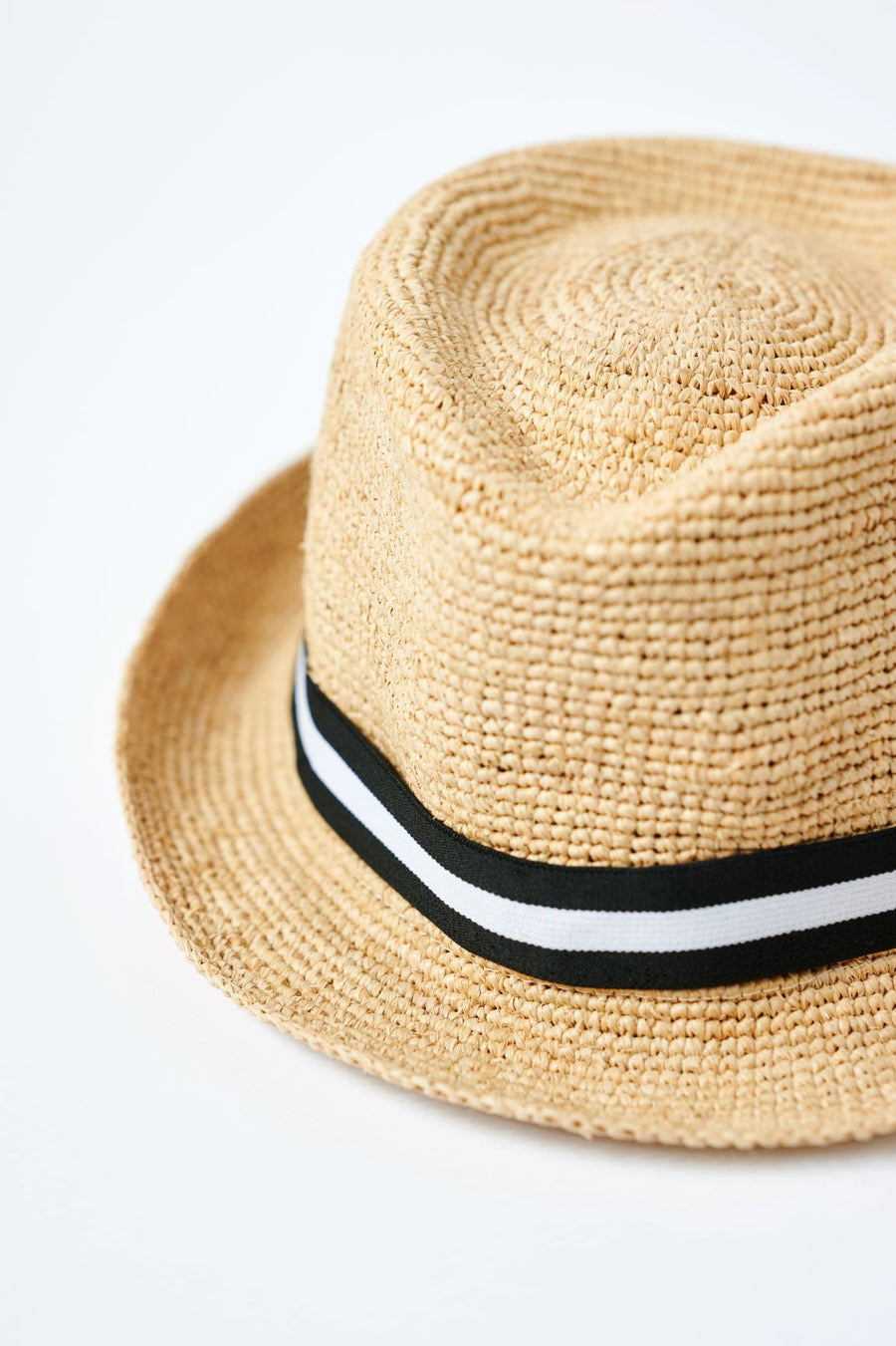 Natural colored crochet straw fedora hat with black & white stripe  band.