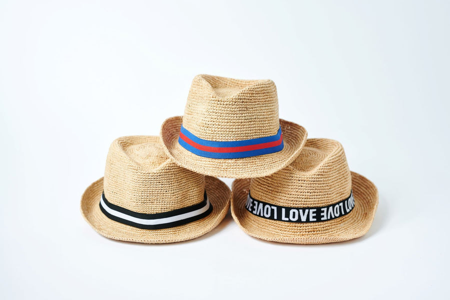 Stack of three natural straw hats.