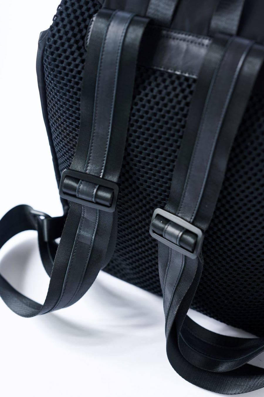 Padded mesh back on the Anya & Niki Delray Backpack - a black nylon backpack with glossy black lining.