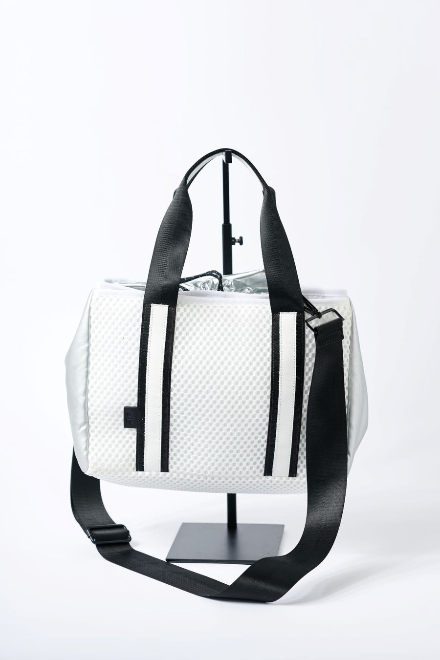 Small white mesh tote with silver cinch top and crossbody strap