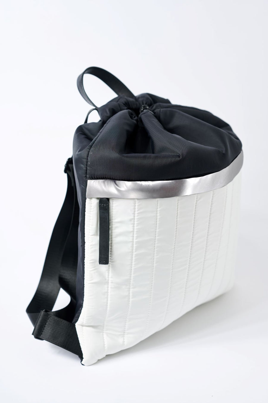 side view of black & white nylon cinch backpack