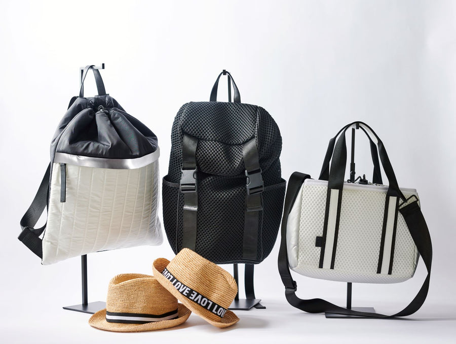 Collection of Anya & Niki active nylon and mesh bags and straw hats.