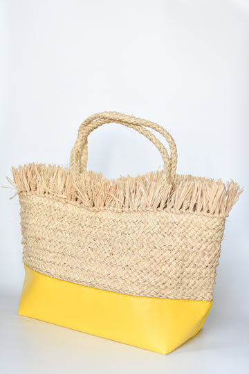 Natural raffia straw tote with linen lining and yellow color block base.