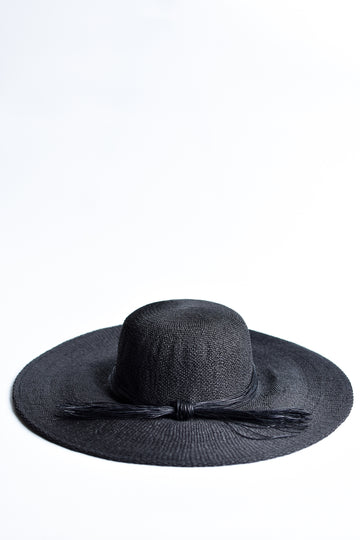 Black floppy straw hat with multi-strand black cording band.