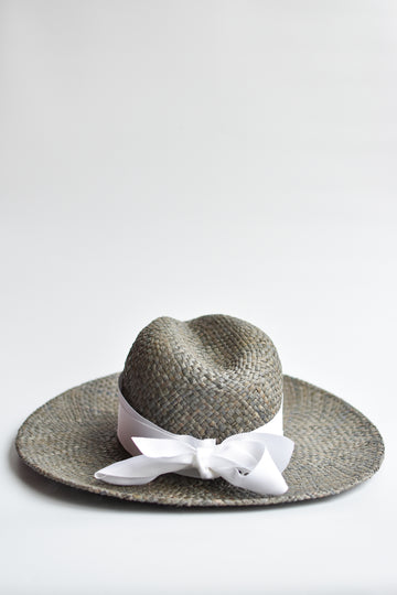 Gray raffia straw panama hat with white grosgrain tie.