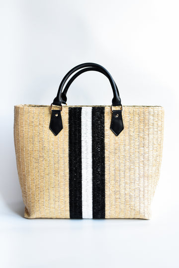 Benicia straw handbag with black leather handles and black & white center stripe.