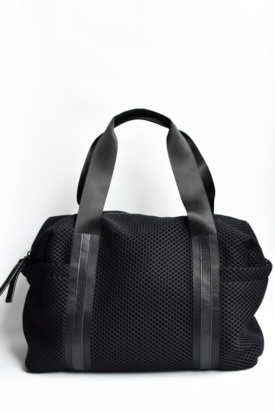 Black mesh duffel bag with leather trim details and black glossy liner.