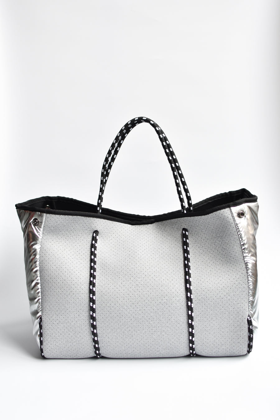 Perforated gray neoprene tote bag with black cord handle and adjustable high shine silver sides.