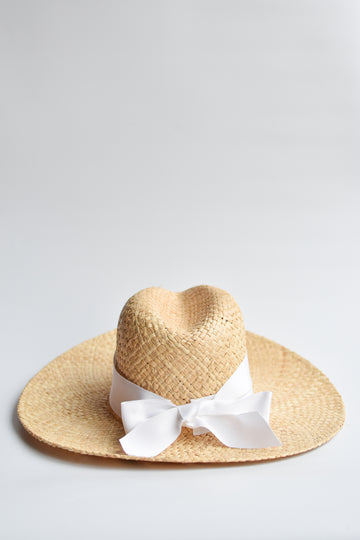 Natural raffia straw panama hat with white grosgrain tie.