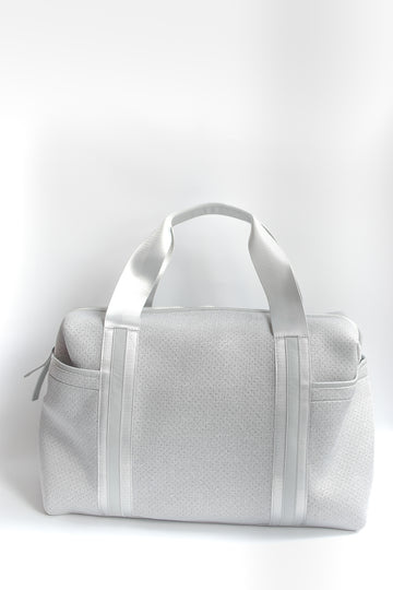 Callahan light gray perforated neoprene duffel bag with grey straps.