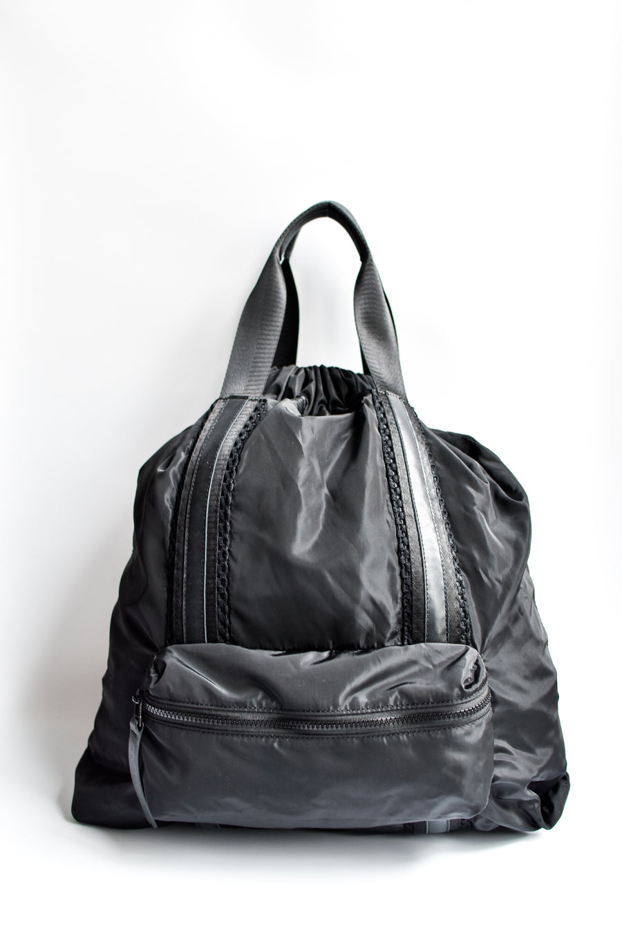 Black nylon convertible backpack tote with leather details.