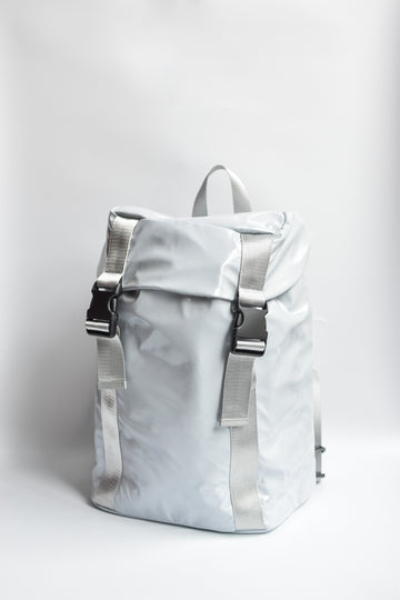 Gray high gloss backpack with gray leather and webbing details.