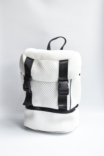 Brooker white mesh backpack with black front straps and bottom zipper compartment with black chunky zipper.
