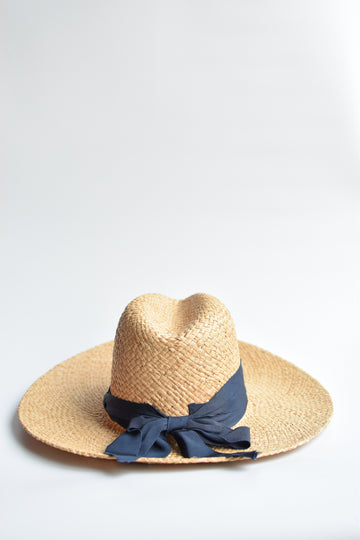 Natural raffia straw panama hat with navy grosgrain tie.
