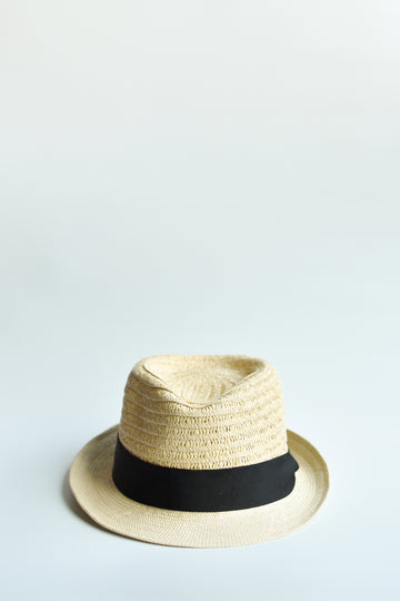 Natural colored straw fedora hat with black grosgrain band.