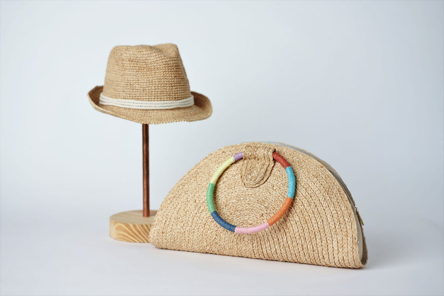 Collection of Anya & Niki Essential crochet straw hat with rope band and the Palma half-moon straw clutch with circle handle.