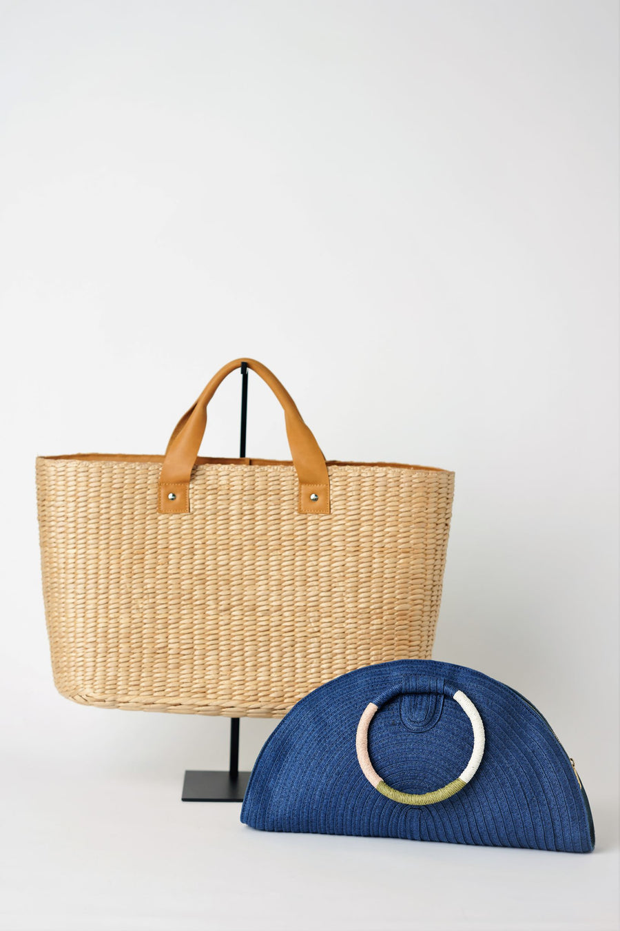 Collection of Anya & Niki Westmont straw bag with leather handles and Posey navy straw half moon clutch.
