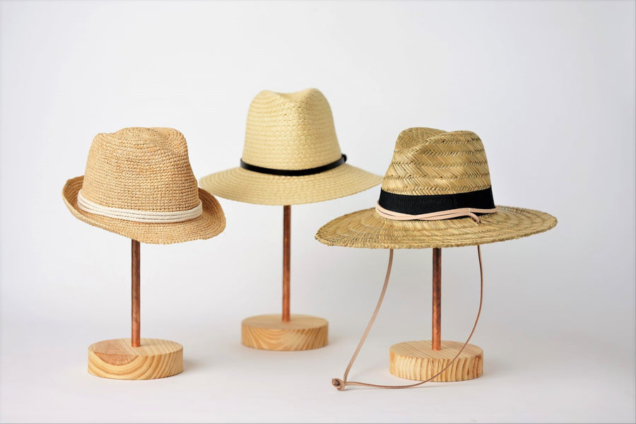Collection of Anya & Niki straw hats, the Essential crochet straw hat with rope band, the Favorite Straw Hat with leather band, and the Tower Straw Hat with leather chin strap.