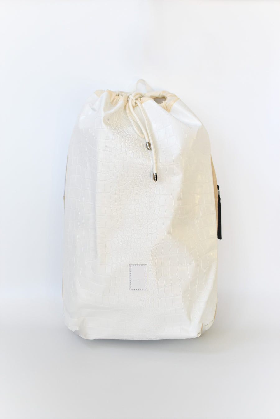 Off white croc embossed Casselberry backpack with cinch top and back zipper compartment.