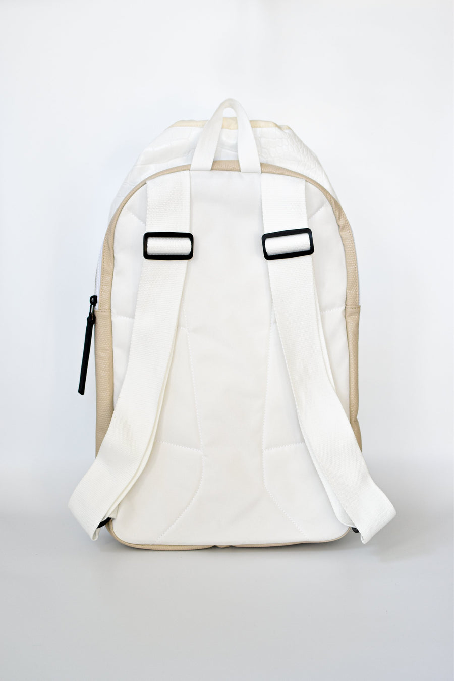 Back strap detail on off white croc embossed Casselberry backpack with cinch top and back zipper compartment.