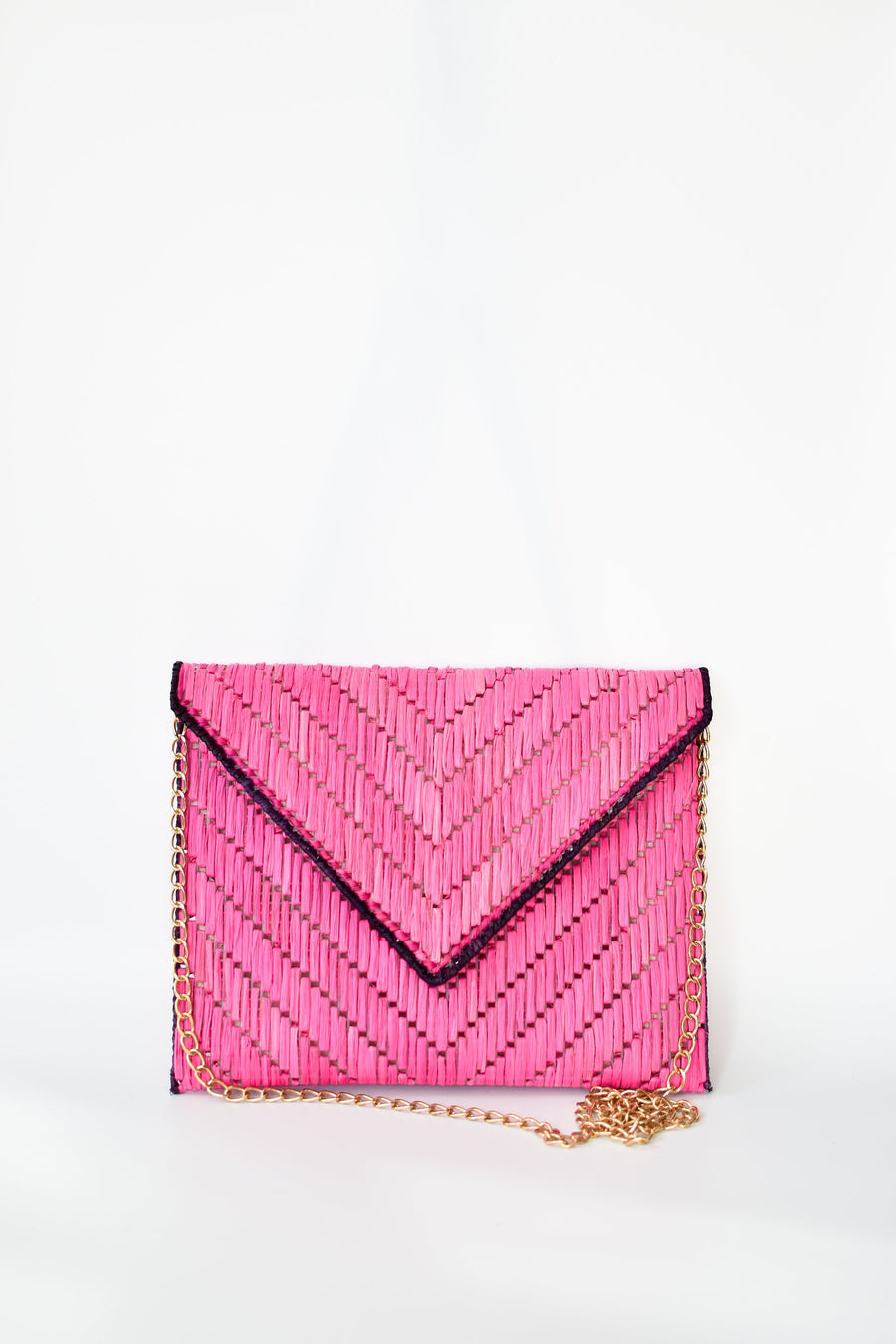 Bright pink woven raffia straw clutch with detachable gold chain strap.