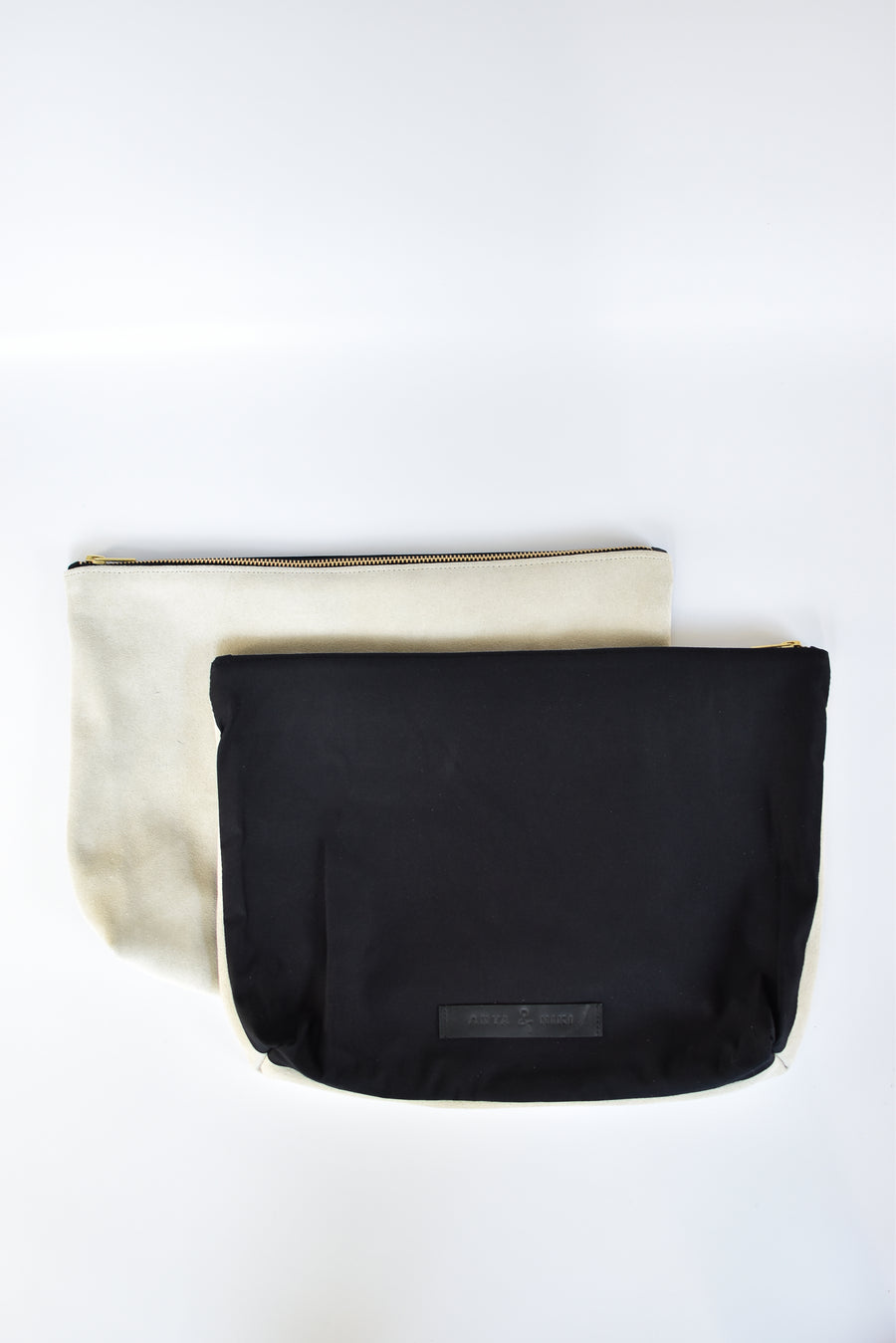 Black cotton canvas and off-white suede large pouch with brass zipper and leather logo label.