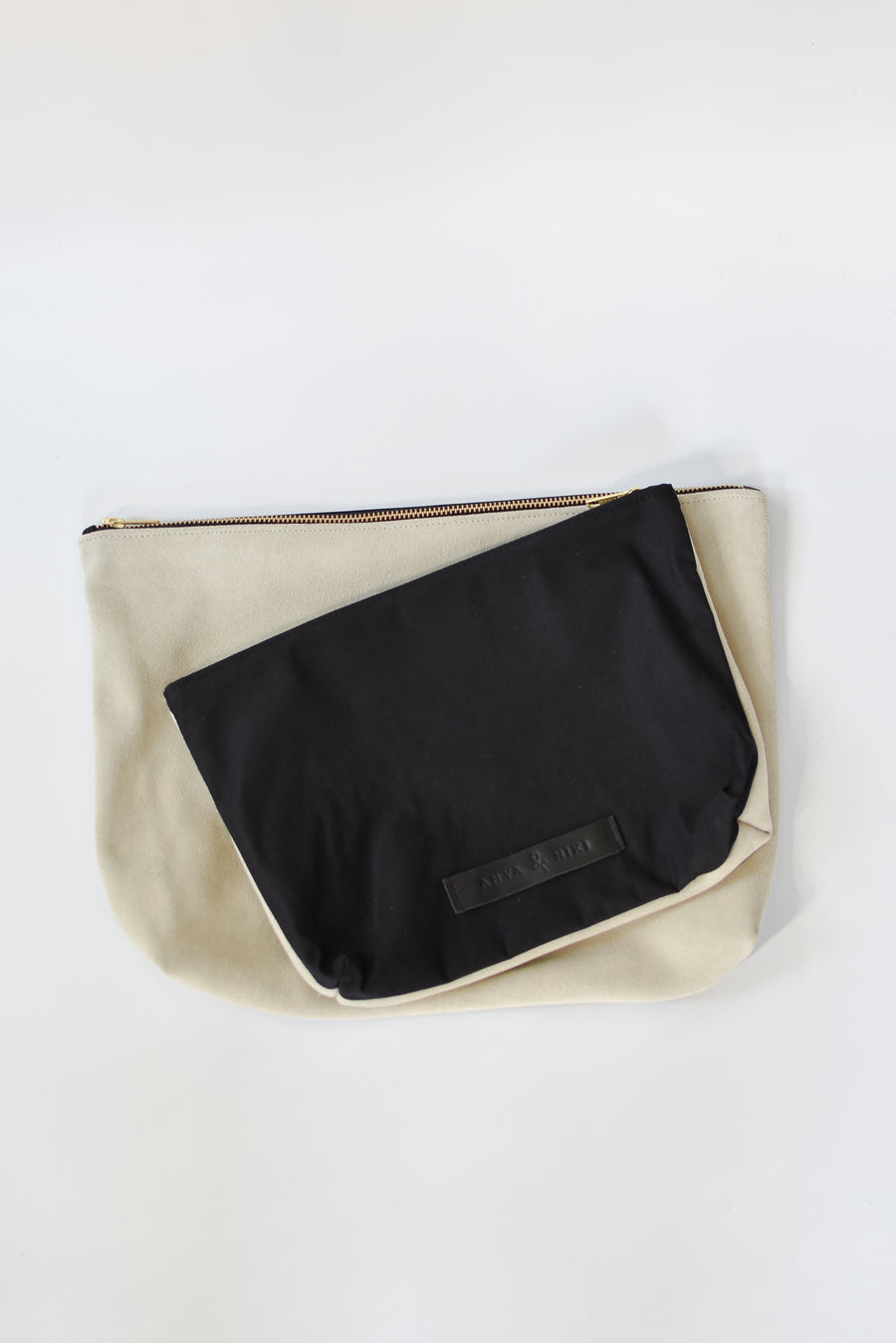 Black cotton canvas and off-white suede medium and large pouch with brass zipper and leather logo label.