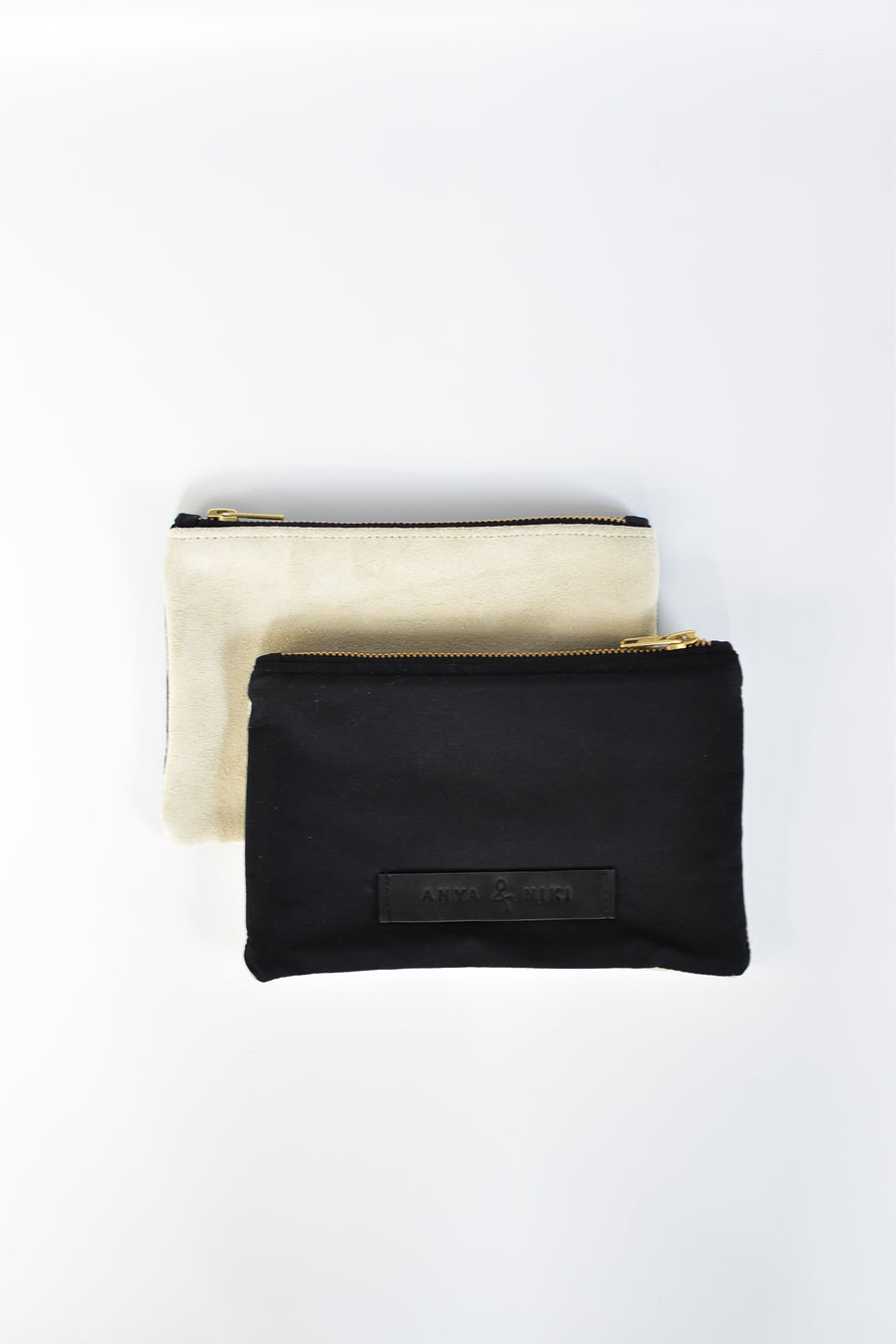 Black cotton canvas and off-white suede small pouch with brass zipper and leather logo label.