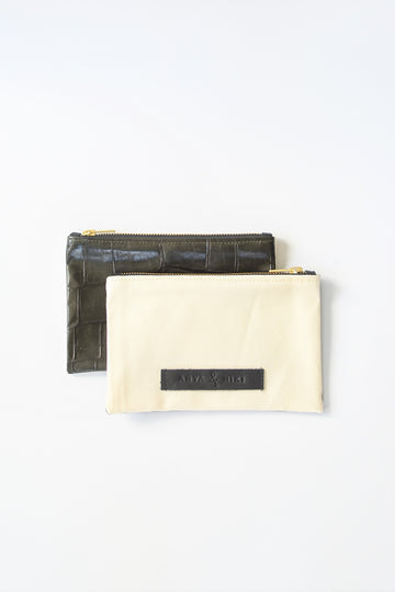 Ecru denim and army green embossed leather skin small pouch with brass zipper and leather logo label.