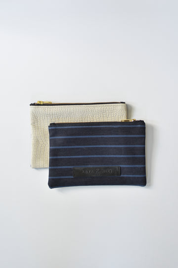 Striped dark denim and off-white croc embossed leather small pouch with brass zipper and leather logo label.