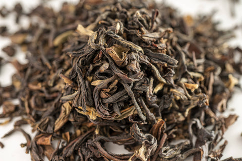 A zoomed in picture of vibrant Darjeeling Tea Leaves by Red Moon Tea.