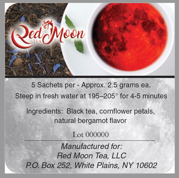 A picture of the description on the back of a Silver To Go Tin of Earl Grey Tea from Red Moon Tea.