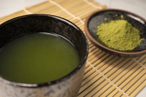 A picture of a teacup full of Matcha Green Tea and Powder by Red Moon Tea.