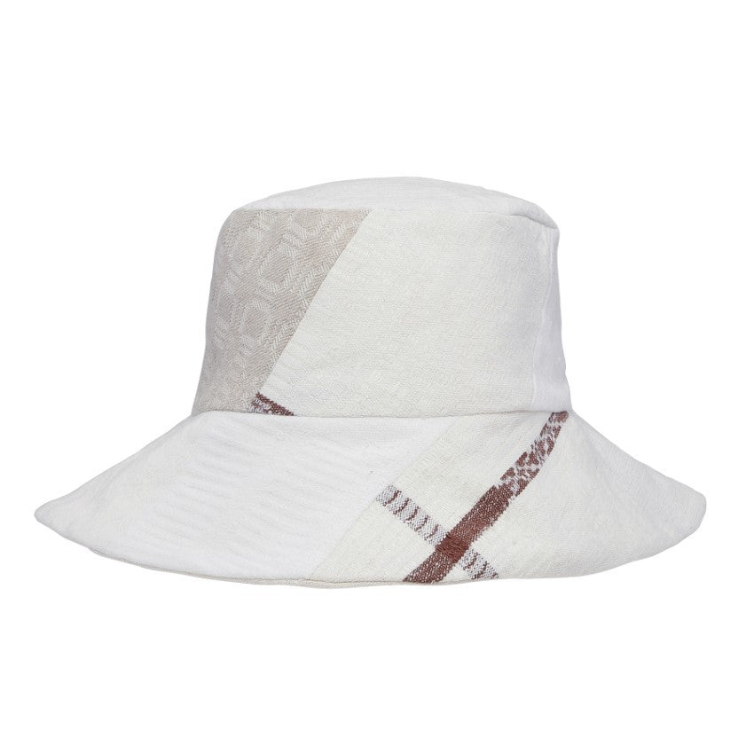 Baker hat made from a mix of washed cotton and linen blankets from the Swedish countryside. This item is one-of-a-kind and made by hand in Denmark.  Linen & cotton
