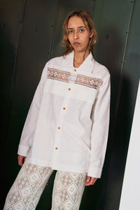 Long sleeve shirt made from Danish cutwork embroidered cotton. This item is one-of-a-kind and made by hand in Denmark.